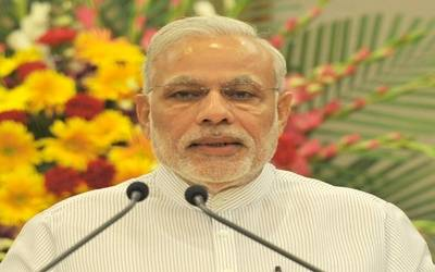 Modi holds up Pune pensioner's example to shame tax evaders