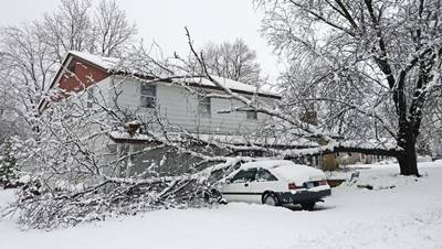 A storm dumped almost a foot of snow causing severe damage in Owatana, US.  (Photo:IANS)